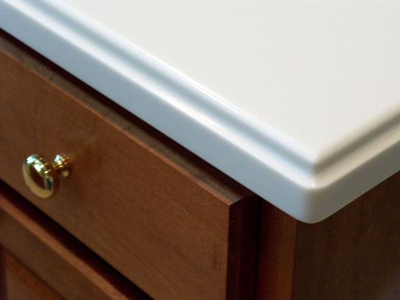 white countertop on a solid maple cabinet